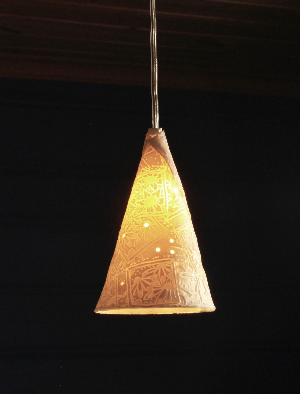 Cone shaped pendant light with abstract floral pattern