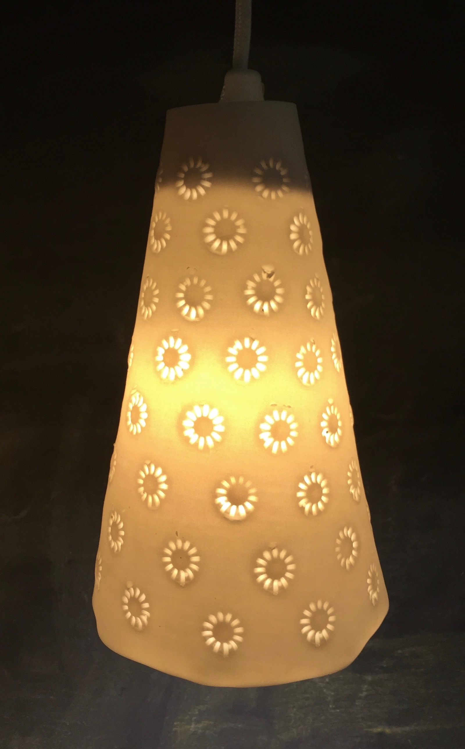 Cone shaped pendant light with daisy pattern