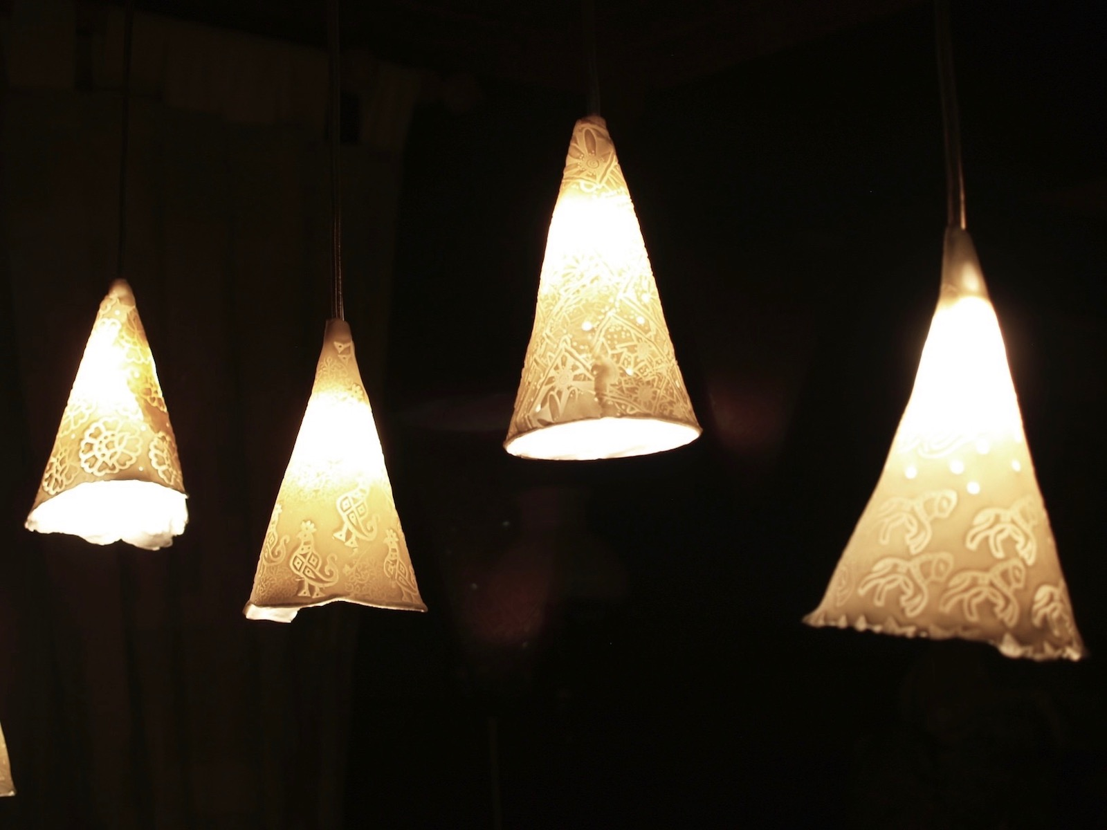 Group of four cone shaped pendant lights