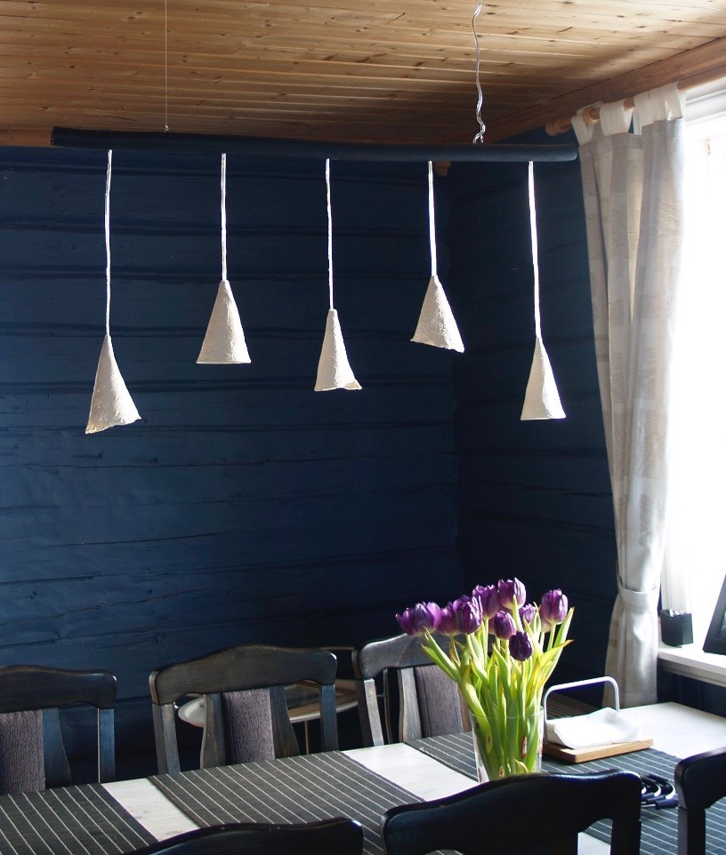 Group of cone pendants above a dining table