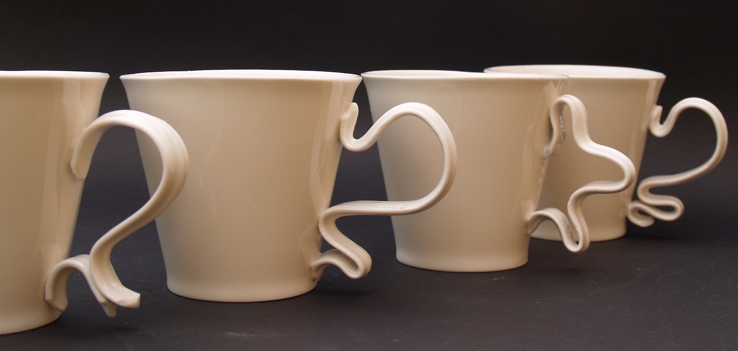Porcelain mugs with squiggly handles