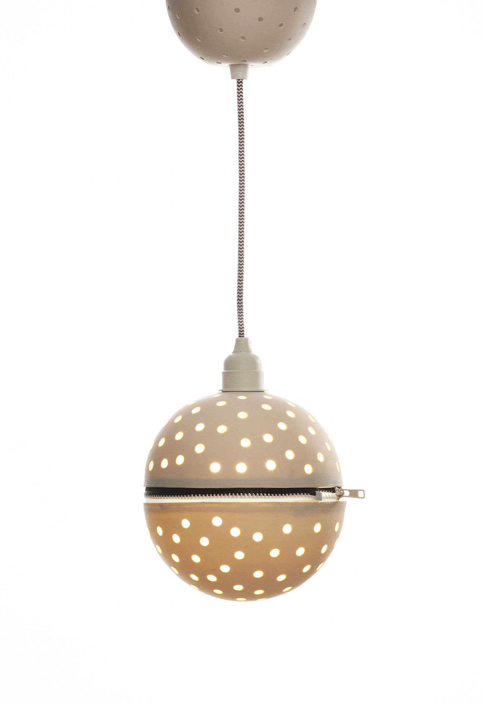 Perforated porcelain globe pendant with black and white zip