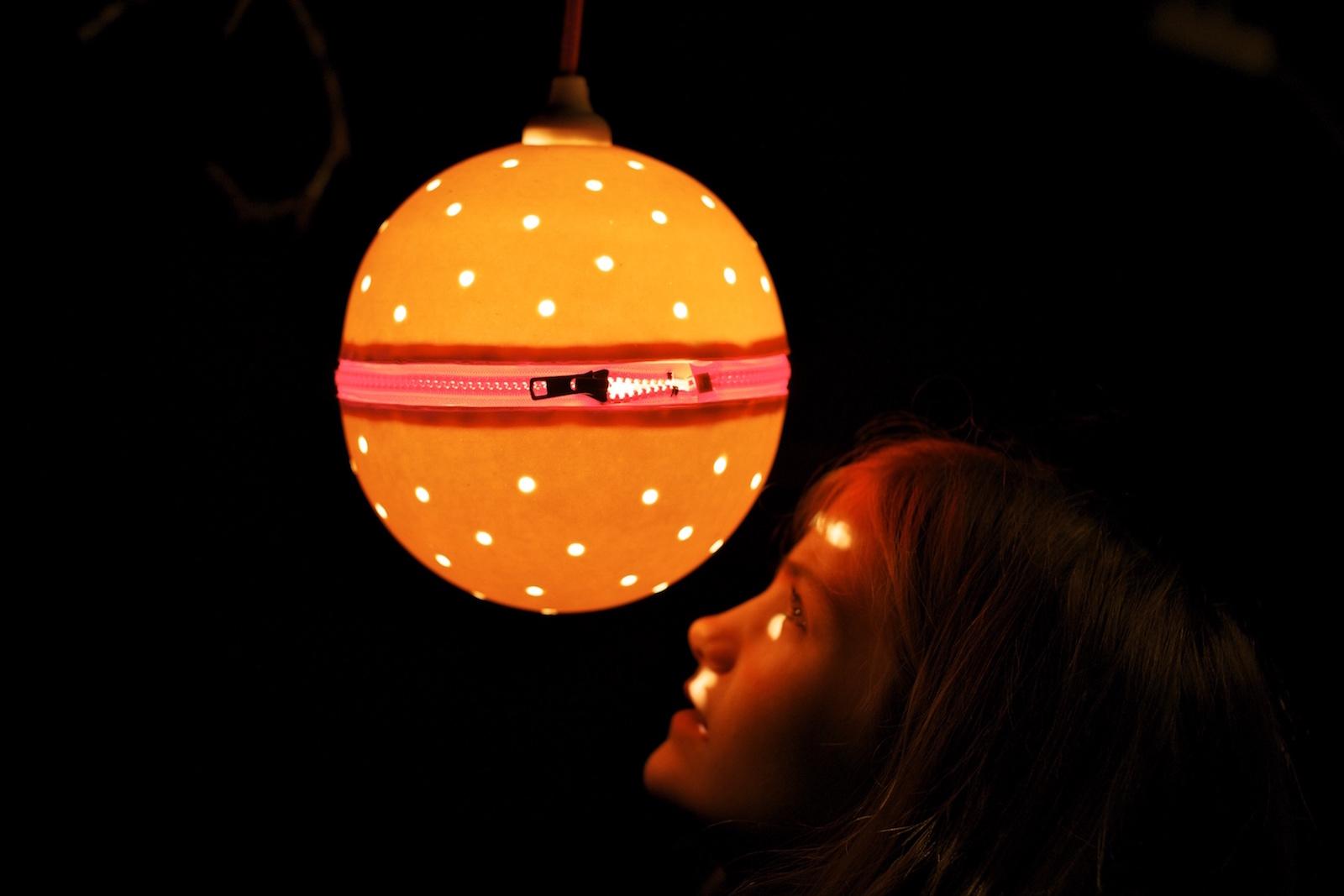 Lit Zzip pendant lamp in dark room