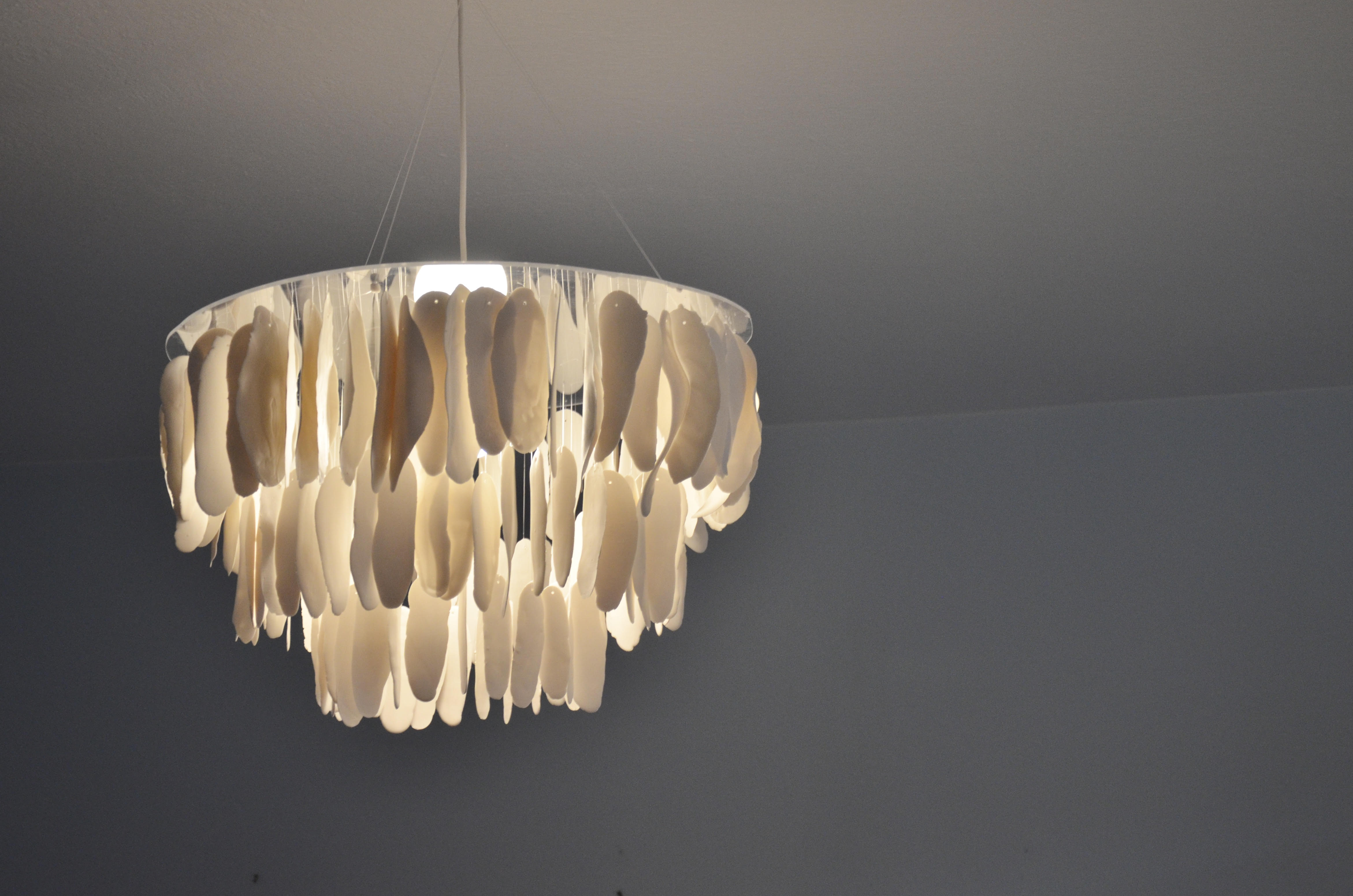 Chandelier made of tranclucent porcelain feathers