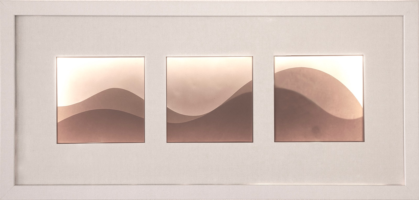 Backlit image consisting of three windows with abstract wave shapes spanning across